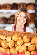 Smiling woman working in a bakery Stock Photos