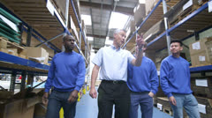 Team of male workers in a warehouse or factory Stock Footage