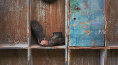 Old boots and helmet of miner Stock Footage