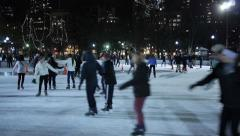 Fun Ice Skating at Night Stock Footage