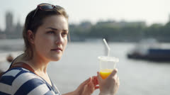 Young woman relaxing looking at view london Stock Footage