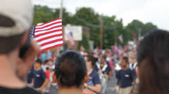 Waving American Flag At Parade Stock Footage