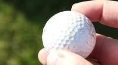 Golf Ball in hand with Green Grass Close Up Stock Footage