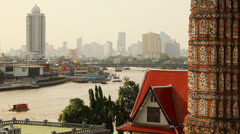 Ancient Thai mosaic and modern city Stock Footage