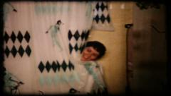 The camera surprises a woman in shower, 228 vintage film home movie Stock Footage