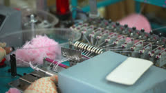 Girl working for machine by hand-knitting Stock Footage