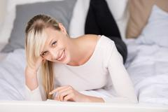 Smiling blond woman Stock Photos