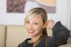 Seductive blond woman with a friendly smile Stock Photos