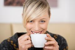 Stock Photo of attractive woman smiling with a cup of coffee