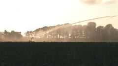 Crop irrigator working - wide - stock footage