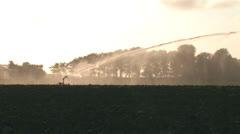 Crop irrigator working - wide Stock Footage