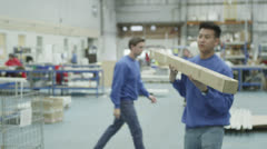 Cheerful factory or warehouse worker taking instruction from the foreman Stock Footage