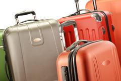 composition with polycarbonate suitcases - stock photo