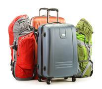luggage consisting of large suitcases and rucksacks isolated on white - stock photo