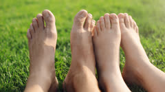 Barefoot feet of young couple in love playing footsie - stock footage
