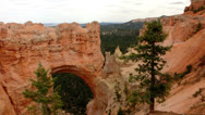 Stock Video Footage of Bryce Canyon 16 Hoodoos and clouds at Natural Bridge