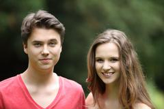 Smiling young teenage boy and girl Stock Photos