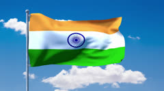 Indian flag waving over a blue cloudy sky Stock Footage