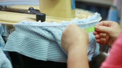 Knitter measuring length of loop Stock Footage