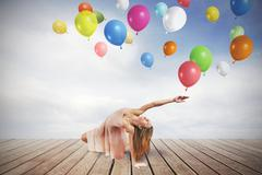 Young girl dance with colorful balloons Stock Photos