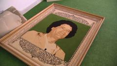 LIBYA -  Kadhafi picture framed, abandonned on the floor - stock footage