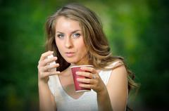 Beautiful girl drinking  coffee Stock Photos