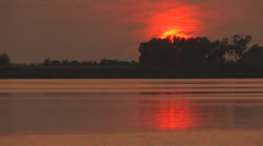 Sunset on river zoom out Stock Footage