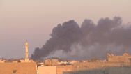 Stock Video Footage of LIBYA - bombing smoke on Tripoli