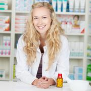 Stock Photo of young smiling female pharmacist