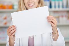 Pharmacist holding blank paper Stock Photos