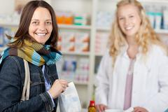 happy customer with a pharmacist - stock photo