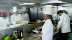 Time lapse of busy team of chefs preparing food in a commercial kitchen - stock footage