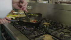 Food being prepared in a hotel or restaurant kitchen - stock footage