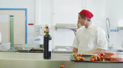 Team of professional chefs preparing food in a hotel or restaurant kitchen Stock Footage