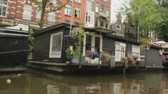 Tour through the Amsterdam Canals with houseboats - stock footage