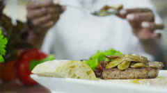 Delicious gourmet dish is being given the finishing touches by the chef - stock footage