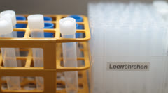 Medical Lab - test  tubes - front track Stock Footage