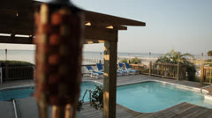 Deck pool with unfocused tiki lamp in view Stock Footage