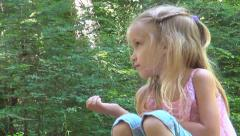 Bored, Sad Child, Tired Little Girl Sitting and Resting in Forest, Children View Stock Footage