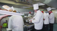 Delicious gourmet burger is prepared by the chef and taken away by the waitress Stock Footage