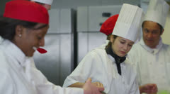 Happy mixed ethnicity team of professional chefs  - stock footage
