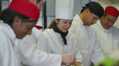Team of professional chefs working together in a commercial kitchen - stock footage