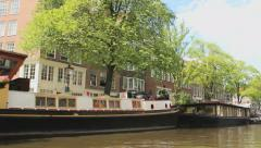 Tour through the Amsterdam Canals with houseboats Stock Footage