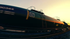 Rail oil car. Crude oil petrol gas cargo transportation. Industrial freight. Sun - stock footage