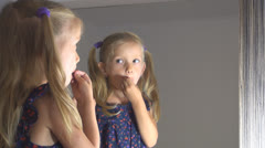 Little Girl Makeup Herself, Child Playing in Mirror, Children Imitating Adults Stock Footage