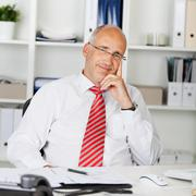 Happy businessman leaning back Stock Photos