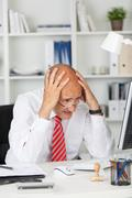 businessman having problems with computer - stock photo