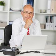 Reliable businessman with hand on chin Stock Photos