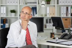 employee looking to side in thought - stock photo