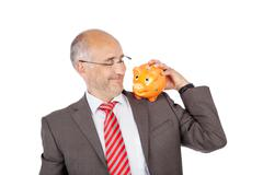 smiling businessman holding piggy on his shoulder - stock photo